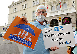 © Licensed to London News Pictures. 13/09/2013. Weston-super-Mare, Somerset, UK. Picture of Mike Campbell from Protect Our NHS, at a demonstration against cuts and privatisation of the NHS, outside the Royal Hotel in Weston-super-Mare during a visit for a private function by Health Secretary Jeremy Hunt who went in through a side entrance avoiding the protest.  The protesters say that Weston General Hospital is in danger of being franchised out to multi-nationals as the local health trust has suffered financial difficulties.  13 September 2013.<br /> Photo credit : Simon Chapman/LNP