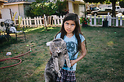 Samantha Olivarez, 9, holds her cat, Furbie, in front of her home in Arvin, Calif. The homes across the street from Olivarez were evacuated after a gas pipe leaked underground. According to reports, the 40-year-old pipe was leaking for as long as two years before it was detected. Olivarez's family is worried about possible health risks in the area due to the pollution.