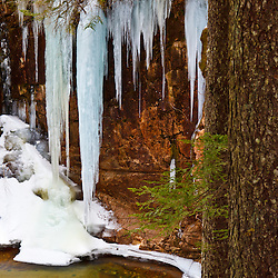 Icicles over the pool below Sabbaday Falls in New Hampshire's White Mountain National Forest.