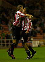 Photo. Glyn Thomas. Digitalsport<br /> Sunderland v Nottingham Forest. <br /> Coca Cola Championship. 14/09/2004.<br /> Sunderland's Julio Arca (R) is congratulated by George McCartney after scoring his side's first goal.