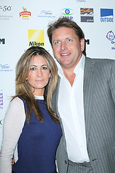 © London News Pictures. Chef James Martin and Louise Davies, Zoom Formula 1 Charity Photographic Auction, InterContinental London, London UK, 07 February 2014. Photo credit:  Richard Goldschmidt/LNP