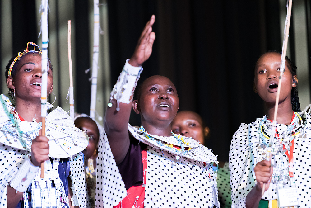 """8 March 2018, Arusha, Tanzania: From 8-13 March 2018, the World Council of Churches organizes the Conference on World Mission and Evangelism in Arusha, Tanzania. The conference is themed """"Moving in the Spirit: Called to Transforming Discipleship"""", and is part of a long tradition of similar conferences, organized every decade. Here, a choir from the Tanzanian Maasai Tribe performs."""