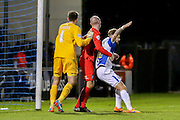 York City midfielder Russell Penn  tussles with Bristol Rovers forward Matt Taylor  during the Sky Bet League 2 match between Bristol Rovers and York City at the Memorial Stadium, Bristol, England on 12 December 2015. Photo by Simon Davies.