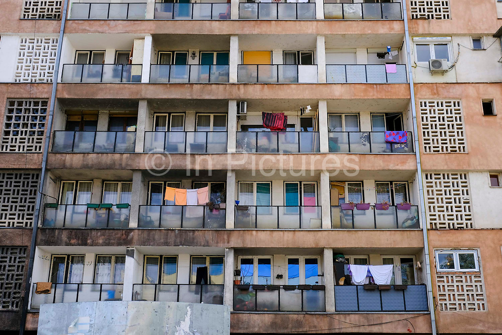 A block of flats just on the on the Serbian side north side of the Mitrovica bridge, over the river Ibar which separates the Serbian and Albanian districts of Mitrovica, Kosovo on the 12th of December 2018.