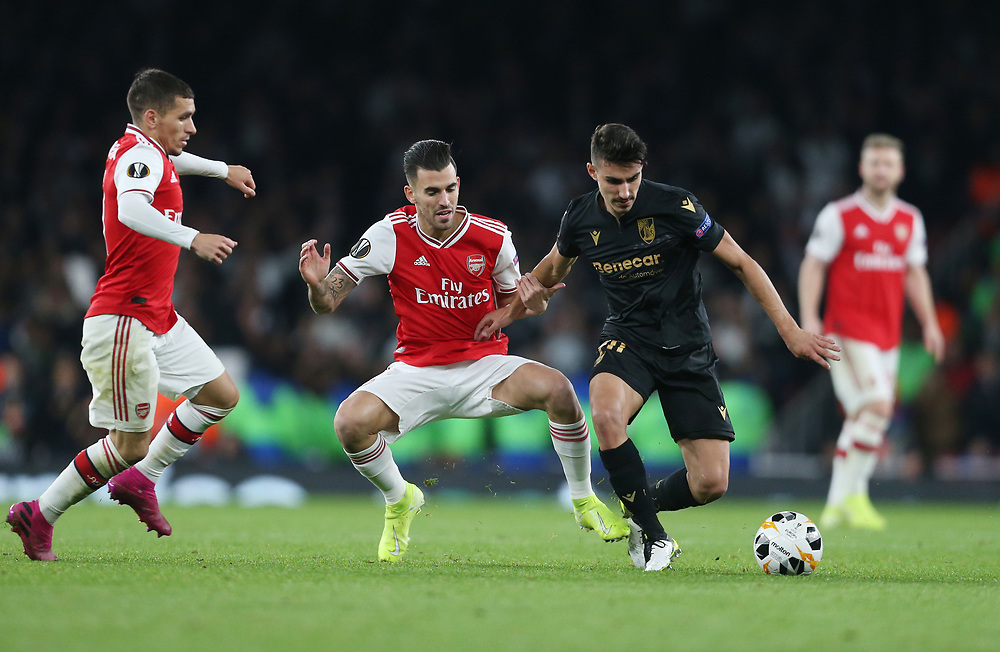 Vitoria's Andre Almeida holds off Arsenal's Dani Ceballos and Lucas Torreira<br /> <br /> Photographer Rob Newell/CameraSport<br /> <br /> UEFA Europa League group F - Arsenal v Vitoria Guimaraes - Thursday 24th October 2019  - Emirates Stadium - London<br />  <br /> World Copyright © 2018 CameraSport. All rights reserved. 43 Linden Ave. Countesthorpe. Leicester. England. LE8 5PG - Tel: +44 (0) 116 277 4147 - admin@camerasport.com - www.camerasport.com