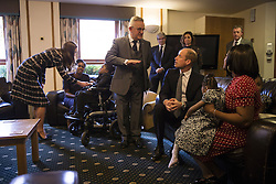 The Duke (2nd right) and Duchess (left) of Cambridge speak with familes receiving support, staff and trustees during a visit to Francis House hospice in Manchester.