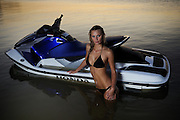 Emily Cochran on Honda Aquatrax R-12 at sunset on Overholser Lake. Model released