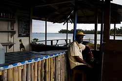 Relaxing in a beachside bar in Port Antonio, home of the Geejam, a luxury boutique hotel with a state of the art recording studio that has attracted famous musicians to make their albums.