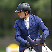 Juan Pablo Pivaral riding Zippo CC in action during the $35,000 Grand Prix of North Salem presented by Karina Brez Jewelry during the Old Salem Farm Spring Horse Show, North Salem, New York, USA. 15th May 2015. Photo Tim Clayton