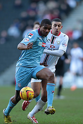 Tranmere Rovers' Stephen Arthurworrey is challenged by Milton Keynes Dons' Daniel Powell  - Photo mandatory by-line: Nigel Pitts-Drake/JMP - Tel: Mobile: 07966 386802 01/02/2014 - SPORT - FOOTBALL - Stadium MK - Milton Keynes - MK Dons v Tranmere Rovers - Sky Bet League One
