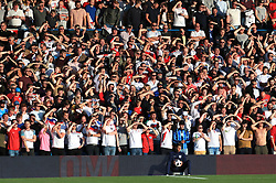 England fans shield their eyes from the sun during the International Friendly match at Elland Road, Leeds.