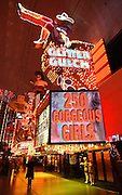 Visitors to the Fremont Street Experience walk past Glitter Gulch, April 20, 2006. Fremont Street dates back to 1905, when Las Vegas itself was founded. In 1931 the Northern Club received one of the first 6 gambling licenses issued in Nevada and the first one for Fremont Street.