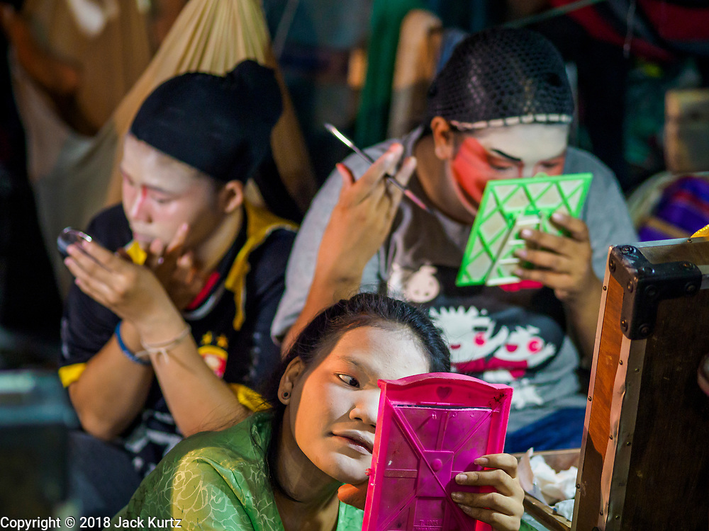 17 OCTOBER 2018 - BANGKOK, THAILAND: Girls put on their makup before the Chinese opera on the last night of the Vegetarian Festival at Chit Sia Ma Shrine in Bangkok's Chinatown. The Vegetarian Festival, also called the Nine Emperor Gods Festival, is a nine-day Taoist celebration beginning on the eve of 9th lunar month of the Chinese calendar. Traditional Chinese operas, called Ngiew in Thailand, are sponsored at many Chinese shrines and temples during the Vegetarian Festival.    PHOTO BY JACK KURTZ