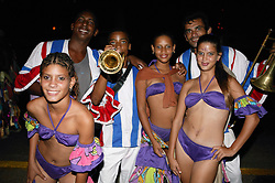 Young women in skimpy costumes at Carnival; Havana; Cuba; with musicians,