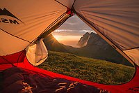Sunset over Bunes beach from inside tent, Moskenesøy, Lofoten Islands, Norway