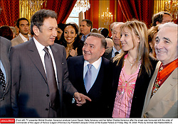 (From left) TV presenter Michel Drucker, Aznavour producer Levon Sayan, Katia Aznavour and her father Charles Aznavour after the singer was honoured with the order of Commander of the Legion of Honour (Legion d'Honneur) by President Jacques Chirac at the Elysee Palace on Friday, May 14, 2004. Photo by Ammar Abd Rabbo/ABACA.