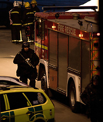 © Licensed to London News Pictures. 13/03/2012..Saltburn, England..Armed police on Saltburn Pier in Cleveland respond to a suspicious person with a bag. Armed police were called to detain the suspect, believed to be a local woman and armed officers carried out a cordon and search of the individual..A military bomb disposal team attended the scene along with other emergency services...Photo credit : Ian Forsyth/LNP