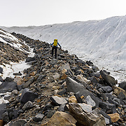 Renee leading up the lateral moraine toward the top of the glacier.