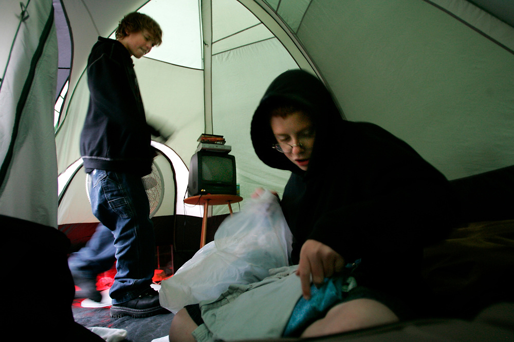 9/28/05 -- Marshall, MO<br /> <br /> With temperatures dropping into the low 40 degree range, Rusty, 13, and Larry, 11, pack up their belongings in their tent at Van Meter State Park after the family found out that a week at Gene's Hotel had been provided by an agency from Interagency Council of Saline County.<br /> <br /> Photo by Jack Gruber, USA TODAY staff