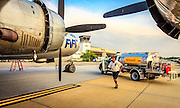 """An Epps Aviation lineman prepares to fuel """"Fifi"""", the Commemorative Air Force's B-29, during a visit to Atlanta's DeKalb Peachtree Airport (PDK)."""