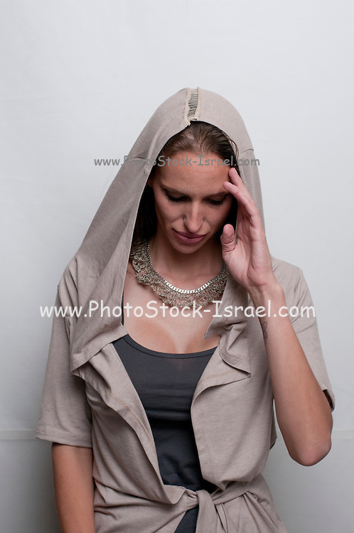 A hip and trendy young woman with hoodie on white background on white background