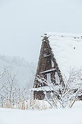 Typical A-shaped house covered in snow in Shirakawa-go, Japan.