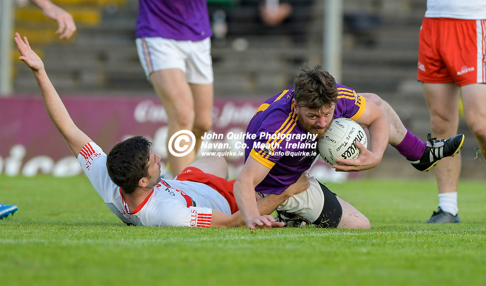 Stephen Sheppard (Wolf Tones) tries to get to his feet,   in the Gaeil Colmcille v Wolfe Tones, 2020 Feis Cup Final match, at Páirc Tailteann, Navan.<br /> <br /> Photo: GERRY SHANAHAN-WWW.QUIRKE.IE<br /> <br /> 02-08-2021
