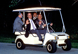 Camp David, Maryland - June 2, 1990 -- United States President George H.W. Bush shows no fear as Soviet President Gorbachev drives a golf cart for the first time at Camp David, Maryland on June 2, 1990. Photo by Ron Sachs / CNP/ABACAPRESS.COM