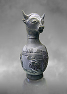 6th century BC Etruscan Bull headed bucherro style oinochoe, or wine jug,  made in Chuisi and excavated from the necropolis de Fonte Rotella, inv 3190, National Archaeological Museum Florence, Italy  , grey art background .<br /> <br /> If you prefer to buy from our ALAMY PHOTO LIBRARY  Collection visit : https://www.alamy.com/portfolio/paul-williams-funkystock - Scroll down and type - Etruscan Florence - into LOWER search box. (TIP - Refine search by adding a background colour as well).<br /> <br /> Visit our ETRUSCAN PHOTO COLLECTIONS for more photos to download or buy as wall art prints https://funkystock.photoshelter.com/gallery-collection/Pictures-Images-of-Etruscan-Historic-Sites-Art-Artefacts-Antiquities/C0000GgxRXWVMLyc