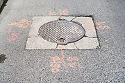 street manhole with utility markings