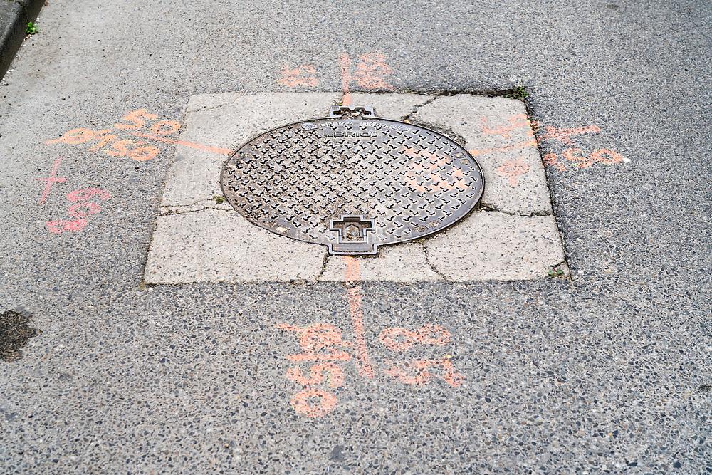 street manhole with utility markings