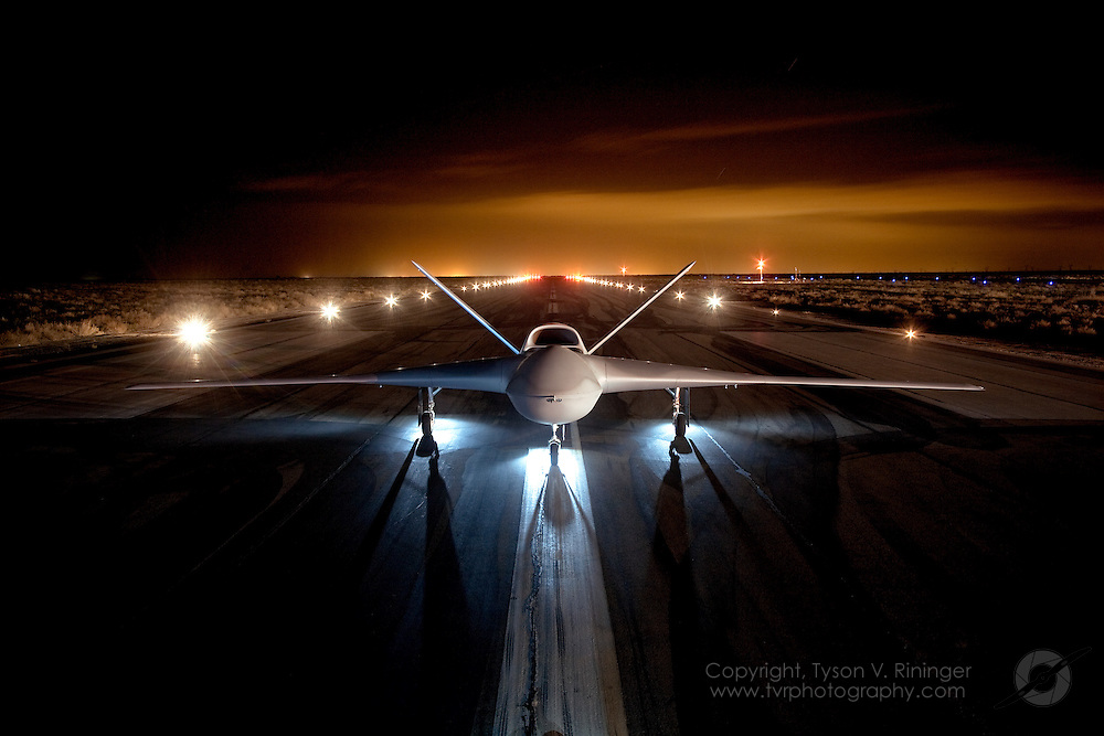 """On a cold night somewhere in a Southern California desert, the Predator C """"Avenger"""", built by General Atomics, is exposed to the camera for it's initial public unveiling."""