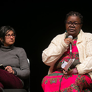 The second day of the Strike WEF march on Davos, 20th of January 2020, Switzerland. Speakers at an event in the Klosters Arena. Njoki Njehu, Pan Africa Coordinator, Fight Inequality, The growing inequality gap and how to stop it. The march started in Schiers and walked the 24 kilomers to Klosters.  The aim is to finish in Davos with a public meeting in the town on the day the WEF begins. The march is a three day protest against the World Economic Forum meeting in Davos. The activists want climate justice and think that The WEF is for the world's richest and political elite only.