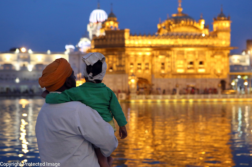 A Sikh pilgrim and his son arrive at the Golden Temple in Amritsar, India before dawn.<br /> Photo by Shmuel Thaler <br /> shmuel_thaler@yahoo.com www.shmuelthaler.com