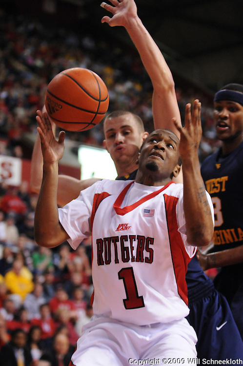 Feb 22, 2009; Piscataway, NJ, USA; Rutgers guard Corey Chandler (1) looses control of the ball when pressured by West Virginia guard Alex Ruoff (22) under the basket during the second half of Rutgers' 74-56 loss to West Virginia at the Louis Brown Athletic Center.