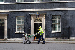 London, November 29 2017. A Westminster City Council street sweeper passes the door of 10 Downing Street. © Paul Davey