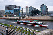 An open top tourist boat sails along the river spree passing Berlin central train station Berlin Hauptbahnhof on 11th October 2019 in Berlin, Germany.