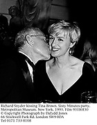 Richard Snyder kissing Tina Brown. Sixty Minutes party. Metropolitan Museum. New York. 1993. Film 93180f30<br />