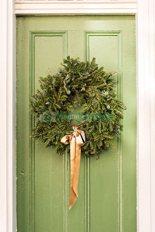 December 21, 2017 - Charleston, South Carolina, United States of America - A green wooden door on a historic home decorated with a Christmas wreath on Tradd Street in Charleston, SC. (Credit Image: © Richard Ellis via ZUMA Wire)