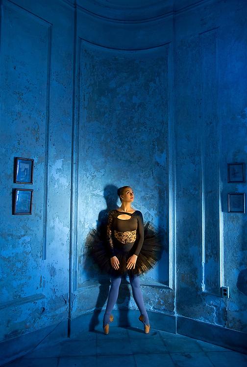 A ballerina from the Cuban National Ballet poses in an Havana, Cuba masion