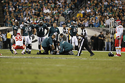 Philadelphia Eagles Head Athletic trainer Chris Peduzzi, Assistant Athletic trainer Joseph O'Pella and Head Team Physician Dr. Peter DeLuca attend to running back LeSean McCoy #25 during the game between the Kansas City Chiefs and the Philadelphia Eagles in Philadelphia. The Chiefs won 26-16. (Photo by Brian Garfinkel)