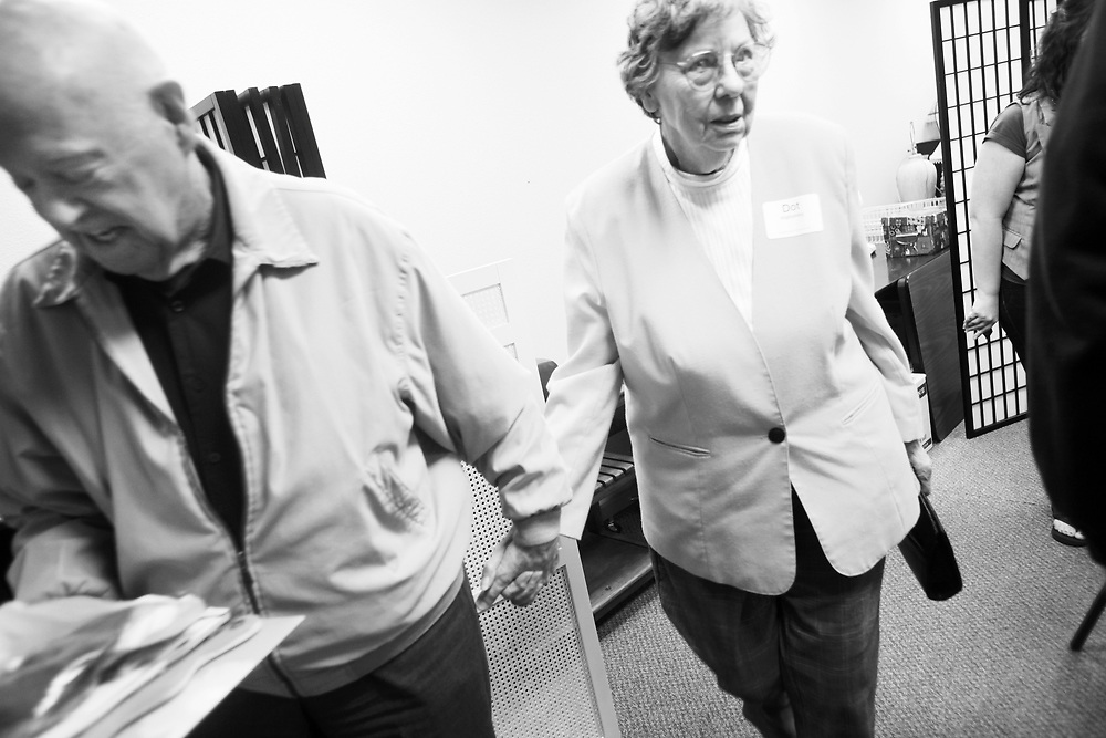 Ivan Mahoney leads his wife, Dot, out of the center. While their caretakers learn new ways of coping in a class at South Salem Senior Center, people with Alzheimer's Disease make new friends on Saturday, Oct. 23, 2010.