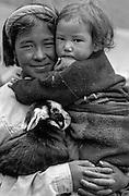BHUTAN, PEOPLE, girls w/ baby goat