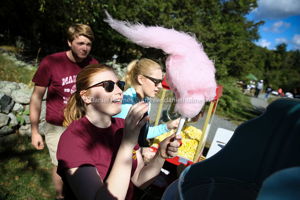 (9/24/16, NORFOLK, MA) From left to right, Evan Bangs, Abby McDonough, and Kerry Morgan, of the King Philip Leo Club, serve up some cotton candy during the Fall Fair at Stony Brook Wildlife Sanctuary in Norfolk on Saturday. Daily News and Wicked Local Photo/Dan Holmes