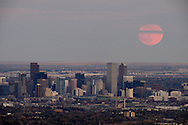 Supermoon over downtown Denver. The last time the #moon was this close to Earth was 1948, and the next time will be November 25, 2034.  This supermoon (named that by an astrologist back in the '70's- very unscientific), combined with atmospheric optic influences such as pollution, Rayleigh scattering (sunset), and the magnifying effect of the atmosphere near the horizon, combined with the distance-compression effect of a 500mm camera lens, all make the moon in this image appear very large.  Astronomy combined with optics is quite interesting!  Go outside and look at the moon tonight, in the morning, and tomorrow night- you won't see this size and brightness again for a while, and there aren't many clouds in America tonight.<br /> <br /> Note that November 2016 is likely to be declared the warmest November in recorded history, as have been every preceding month in 2016, as 2016 becomes the first year in millennia with every month showing a global measurement of over 400 parts per million of carbon dioxide in the atmosphere. Denver continues to experience abnormally warm weather, creating snowless, near-cloudless conditions to view this supermoon.<br /> <br /> This image was made from Green Mountain in Lakewood, CO.