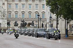 © Licensed to London News Pictures. 18/06/2020. London, UK. A convoy carrying French President Emmanuel Macron arrives in The Mall enroute to Clarence House where he will meet with Prince Charles. President Macron will later meet with Prime Minister Boris Johnson in Downing Street where they will watch a fly past by the Red Arrows and the Patrouille de France (PAF), the aerobatics demonstration team of the French Air Force. Today's events commemorate the 80th anniversary of the Second World War resistance leader General Charles de Gaulle's historic broadcast to occupied France on June 18, 1940. Photo credit: Peter Macdiarmid/LNP