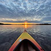 Sunrise viewed from kayak on a lake, Minnesota