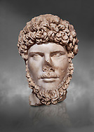 Roman statue of Emperor Lucius Verus .Marble. Perge. 2nd century AD. Inv no 2010/539 . Antalya Archaeology Museum; Turkey. Against a grey background .<br /> <br /> If you prefer to buy from our ALAMY STOCK LIBRARY page at https://www.alamy.com/portfolio/paul-williams-funkystock/greco-roman-sculptures.html . Type -    Antalya     - into LOWER SEARCH WITHIN GALLERY box - Refine search by adding a subject, place, background colour, museum etc.<br /> <br /> Visit our ROMAN WORLD PHOTO COLLECTIONS for more photos to download or buy as wall art prints https://funkystock.photoshelter.com/gallery-collection/The-Romans-Art-Artefacts-Antiquities-Historic-Sites-Pictures-Images/C0000r2uLJJo9_s0