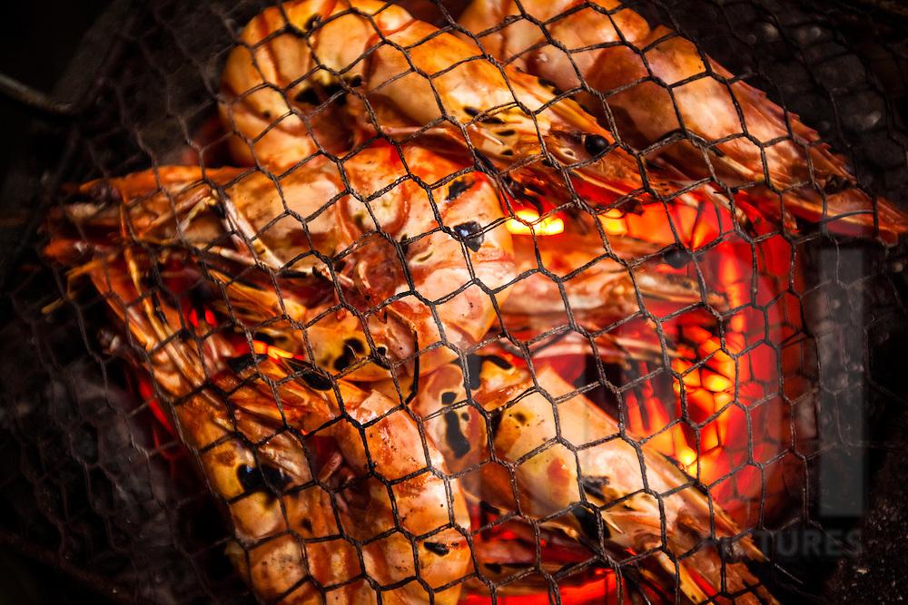Grilled shrimp in a street restaurant along Cau Go, Hanoi, Vietnam, Southeast Asia