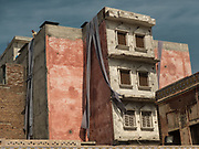 Street scene in and around the Walled City of Lahore. Dyers dying cloth.